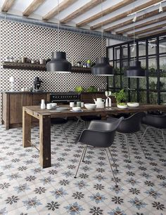 Would you cover your kitchen with patterned tile? From bright and bold to just a touch, here are six ways to make the trend suit your style. | 5. Create a complement. Combining two tile patterns can also work to great effect. To keep things pulled together, stick with colors from the same palette and patterns on different scales. photo via Perrini.