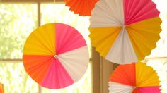 Hanging Paper Fan Medallions: How to Make || KIN DIY, via YouTube.
