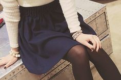 Skirt and sweater, tights and accessories