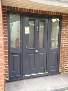 Stunning Ludlow 2 in Anthracite grey and matching sidelights fitted in Hertford by Rock Solid Doors Front Door Porch, Grey Front Doors, Porch Doors, Modern Front Door, Front Door Entrance, Exterior Front Doors, House Front Door, Front Door Colors, House Entrance