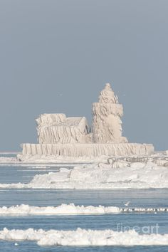 Cleveland Harbor West Pierhead Light covered by frozen layers of ice due to crashing waves in frigid temperatures during mid-December 2010.