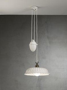 Anita | Indoor suspension lamps, appliques, ceiling lamps, table and floor lamps made of ceramic and brass