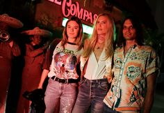 Camille Rowe in Re/Done jeans, Djuna Bel in Re/Done jeans, and Nikolai Haas