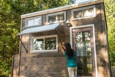 A metal panel is turned into an awning for the kitchen window. It can be dropped down and stored for the drive if someone wants to let the sunshine in or if this tiny house hits the road.