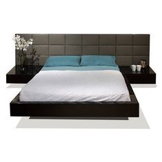 Sharon Bed  TheSharon Bed utilizeswood andleather to create an extremely contemporary design.Raised on a slight platform, the modern bed looks to be floating. The bed's leather headboard bringselegance to any contemporary bedroom. The attached nightstands add to the elegance by creating sleek lines and simple beauty.   Italian style low platform bed Bonded leather headboard Two attached nightstands Slats included (no box spring required)