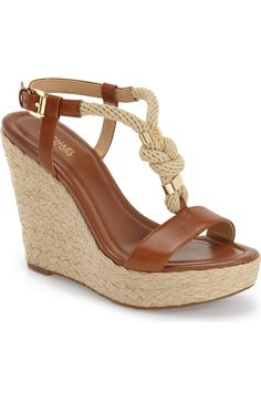 These Michael Kors espadrille wedge sandals display nautical influence with a knotted rope T-strap and polished hardware.