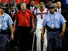 Louisville Cardinals guard Kevin Ware heads out to the court before the championship game at the Georgia Dome.