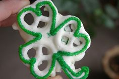 Celebrate St. Patrick's Day with these yummy shamrocks made from yogurt-covered pretzels.    Ingredients            waxed paper          3 yogurt covered mini pretzels          1/4 teaspoon vegetable oil            1/4 cup white chocolate chips          green icing          decorating sugar    Instructions            To make a batch, cover a work surface with a sheet of waxed paper. For each clover, arrange three yogurt-covered mini pretzels and a pretzel section as shown.            Combine 1/4 teaspoon vegetable oil with 1/4 cup white chocolate chips and melt them together in the microwave according to the chips' package directions. Dab the mixture between the pretzel pieces to adhere them. Let the chocolate harden.            Working with one clover at a time, pipe the edges and stem with green icing (we used a #8 round piping tip), then quickly sprinkle it with decorating sugar (we used white, light green, and dark green).    Tips:      To save sugar, sprinkle each clover on a small piece of waxed paper. After you've covered a few treats, use the paper to funnel the extra sugar back into its jar.
