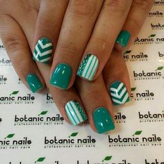Stylish Eve--green nails with cute designs.