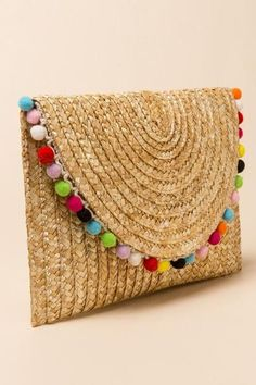 but maybe white Pom poms or big gemstones instead...  Rainbow Pom Pom Straw Clutch |                                              francesca's