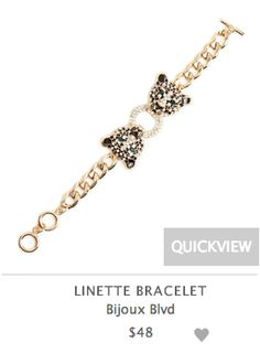 Two cz adorned black and gold leopards meet in the wildly bold Linette bracelet. Take a walk on the wild side in Linette's gold, black, and white tones-- a compliment to day and night looks alike.