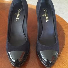 Authentic Chanel Pumps! These are in excellent condition.  Has wear on bottom soles.  I believe the color of these shoes is either a dark blue or black. I think they are black because the front patent leather is black. They say 41 but I think it fits a size 10 CHANEL Shoes Platforms
