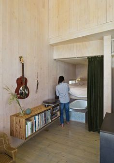 Could build a floating bookshelf / record shelf for under the window in the living room