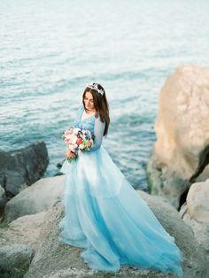 A Cinderella-esque destination wedding gown...what's not to love?!   Powder Blue Wedding Dress via @burnettsboards