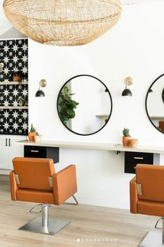 Home Remodel Contractors Matte black round mirrors paired with swing arm wall lamps are everything in this modern, minimalistic interior design of this salon designed by Morgan Mullen Design. Home Beauty Salon, Home Hair Salons, Beauty Salon Decor, Beauty Salon Design, Beauty Salon Interior, Home Salon, Vintage Hair Salons, Salon Lighting, Salon Styling Chairs