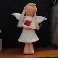 Handmade wooden angel to add to the tree