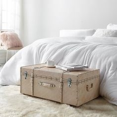 Mercer41 Adding storage to your space doesn't mean you have to sacrifice style! The Texture® Brand Trunk has two wheels, two feet, and a stylish exterior that will add to your room décor. This rolling footlocker is the perfect size to fit at the end of your college dorm bed, under your bed to save space, or doubles as a unique coffee table for your home. Padlocks can be added to the two latching clasps on the front of this trunk to provide you with extra peace of mind. Whether you're a college f College Furniture, College Bedroom Decor, College Dorm Bedding, Dorm Room List, Dorm Rooms, Classy Dorm Room, Dorm Desk, College Dorm Essentials, Orange Candy