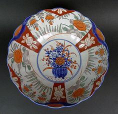 19th Century Japanese Hand Painted Porcelain Imari Bowl with a Scalloped Edge Rim. Nicely Detailed with an Overall Floral Design and Vibrant Colors. Surface Wear and Minor Roughness Consistent with Age Otherwise in Very Good Condition. Measures 4-1/4 Inches Tall 10-3/4 Inches Diameter.