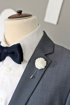 A personal favourite from my Etsy shop https://www.etsy.com/listing/204530114/elegant-white-carnation-boutonniere-mens
