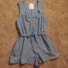 "Free People Rare Denim Romper Beautiful and unique Free People romper! 3/4 zip down the middle and flattering sweetheart neckline. Elastic at the waist with belt loops and a belt. 100% cotton, 31"" from top to bottom. Size 12, L. Runs a little bit small so would best fit a bigger medium or a smaller Large. In excellent condition, no flaws! Make me an offer!!! :) Free People Dresses Mini"