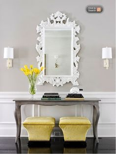 Like the sconces and the color of grat, and the white mirror --yellow stools, not so much, but do like the color.