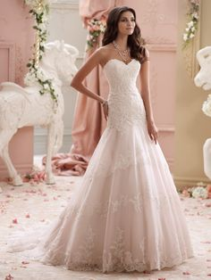 David Tutera for Mon Cheri - 115249 � Adalynn - Blush pink wedding gown, strapless corded lace appliqu�, tulle and organza over satin A-line wedding dress with sweetheart neckline featuring delicate eyelash trim, hand-beaded corded lace appliqu�d bodice with dropped waistline, slightly curved back bodice adorned with cascading covered buttons, layered tulle and organza skirt features matching lace appliqu�s with beaded accents spilling down to scalloped hemline with eyelash trim and chapel…