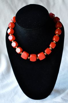Happiness is a delicious Machine-Age choker with cherry-red Bakelite beads!    The graduated beads are perfect cubes with truncated corners. Size: 14