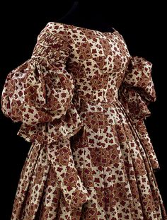 Dress  Place of origin:  England (made)    Date:  1836-1838 (made)    Artist/Maker:  Unknown    Materials and Techniques:  Printed wool, trimmed with printed wool, lined with cotton, hand-sewn
