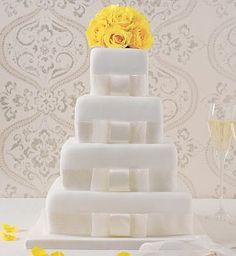 Classic square wedding cake featuring fat ribbon embellishment. Each tier reminds me of a jewellery box.