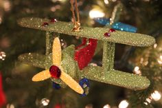 All glittered airplanes with red gem accents for the little guys on your list.  www.exclusivelychristmas.com