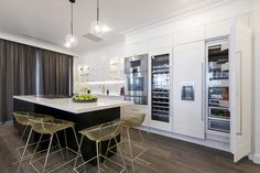 """In their """"restaurant-quality kitchen"""", Julia and Sasha wowed with Gaggenau appliances, gorgeous gold stools and charming artworks – 'Shifted Love' and 'Wildflower'. Decor Interior Design, Modern Interior, Interior Decorating, Kitchen Reno, Kitchen Cabinets, Kitchen Ideas, The Block 2016, The Block Kitchen, Duplex Design"""