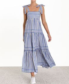 The Verity Stripe Tiered Tie Dress in Blue Stripe from our Summer Swim 2019 Collection. A striped maxi dress featuring a full A-line skirt for volume and movement with fixed tie shoulder straps. cotton, maxi dress with full a-line skirt, fitted at bust, Simple Dresses, Casual Dresses, Fashion Dresses, Emo Fashion, Maxi Dress Summer, Striped Maxi Dresses, Sleeveless Dresses, Tutu Dresses, Linen Dresses
