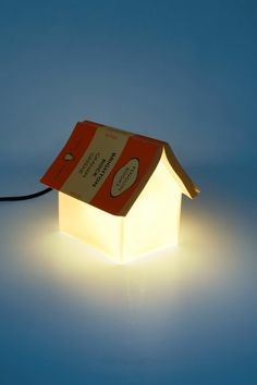 A cute little book rest that doubles as a bookmark as well as a reading lamp(It looks like a small house too). The book rest lamp was ma.