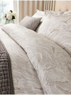 Marble Pattern Duvet Covers Makrana features an all-over marble pattern with beige highlights with a moonstone-coloured plain on the reverse, and is finished with button fastenings. Please Note: Pillowcases are not included with these duvet covers Super King Duvet Covers, Double Duvet Covers, Single Duvet Cover, Marble Bedding, Big Beds, Embroidered Cushions, Marble Print, Cotton Duvet, Luxury Bedding