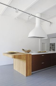 Great modern butcher block addition & loving the extractor fan, white is so much nicer than steel...