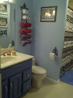Bathroom - trying to decide if we should paint our vanity white or keep it brown when we do our bathroom