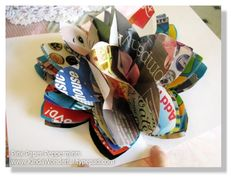recycled paper flower  The tutorial is here:  kindawonderful.ty...