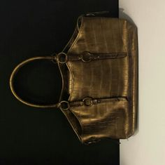 Olive colored, Gold Nine West purse Like an olive color,Nine West purse in perfect condition.  I bought but never usesd!  It's still awesome looking to me though! Nine West Bags Shoulder Bags