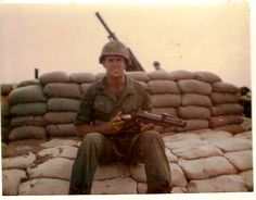 Cpl. Mick Johnson, a member of the 1st Cavalry Division, sits at a 105 mm howitzer emplacement at Landing Zone Jamie near Tay Ninh, Vietnam in 1969 shortly before they were almost overrun by North Vietnam Army troops. Photo provided by Betsy Bracy.