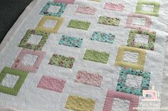 Close-up pics of quilting design is lovely! A few details about this quilt.  Pattern is: Tumbling Blocks by Kimberly Jolly for It's Sew Emma Patterns  Fabric is: Vintage Baby by Lori Whitlock for Riley Blake Fabrics  Backing fabric is: Snuggles by Moda Fabrics  Patterns and kits are available for purchase at the Fat Quarter Shop.