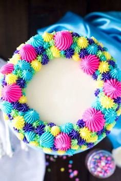 A sweet funfetti layer cake (also known as confetti cake) with colorful buttercream frosting || Sugar Spun Run