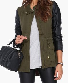 olive green canvas jacket with black leather sleeves