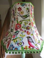This is a handmade lampshade in a Hexagonal style frame.  	This gorgeous print is filled with bold colour. Simple bird and fl..