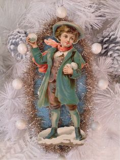 Boy With Snowballs Large Victorian Scrap Christmas Ornament With Antique Dresden Star.  via Etsy.