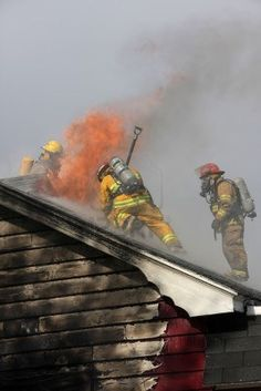 Firefighters doing roof ventilation as they battle a structure fire.