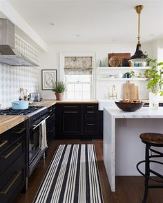 Butcherblock counters with black cabinets...