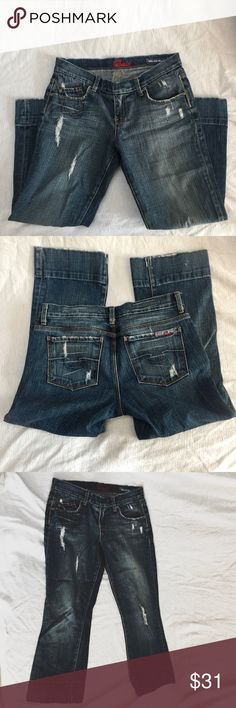 "Cropped Blue Cult Jeans Slight Flare Rare These are a great pair of stylish, perfectly proportioned cropped jeans. No longer fit me, or else I'd be wearing them right now! They have perfectly placed distressed areas - all part of the original design. Waist about 15"", total length about 24"" (laid flat). Blue Cult Jeans Ankle & Cropped"