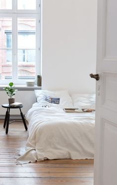 Scandinavian Style. The minimalistic addition of a stool and plant is striking.