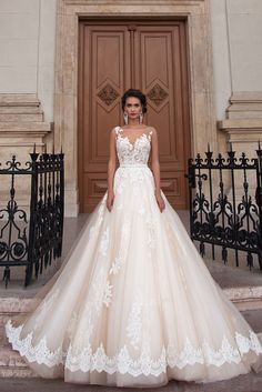 Jeneva - Delicate Pearl - MillaNova Tender and stylish wedding dress Jeneva in A silhouette with transparent corset decorated by lace, fluffy skirt with multiple layers of different mesh cut, under the top layer covered with the lace there is also the Shantiler lace decoration.