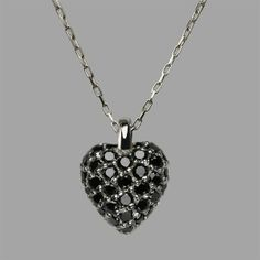 Our scrumptious black diamond Raspberry Heart pendant necklace handmade in our London workshops with thirty-three pavé set brilliant cut diamonds